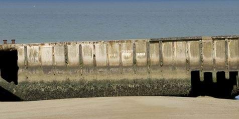 Mulberry Harbour on beach in Normandy